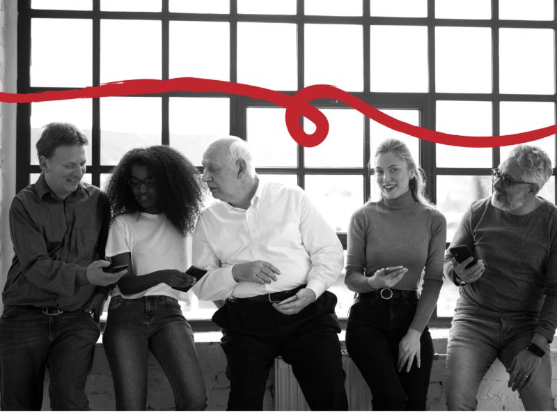 Coworkers looking at phones