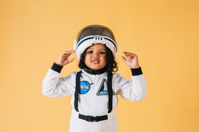 Inclusive Approach to Authentic Buyer Personas: Black girl wearing astronaut costume