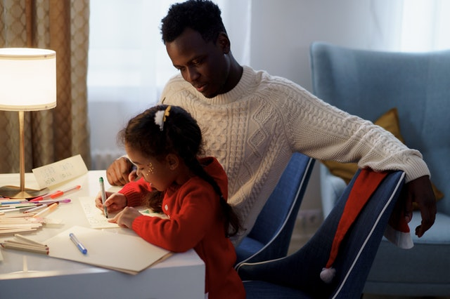 Inclusive Approach to Authentic Buyer Personas: Black man helping daughter write letter to Santa