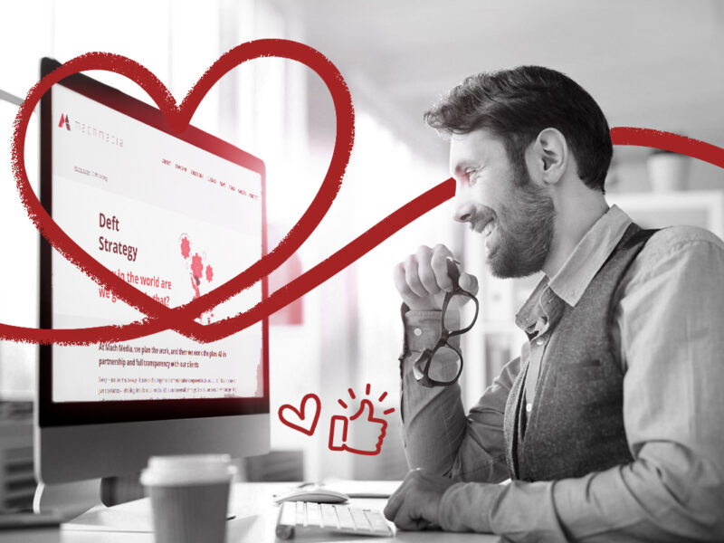 Improve your marketing design: man looking at computer